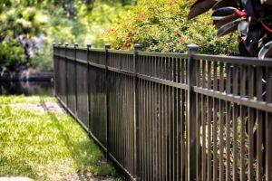 A beautiful iron fence around a yard